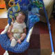 My son with our first Fisher Price swing.