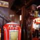 Old jukebox and carved wooden sculpture