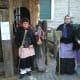 Italian ladies dressed like la Befana on January 6.
