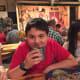 Our son Ben enjoys a lemonade at the Circle B Chuckwagon dinner.