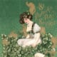 Vintage St. Patrick's Day greeting card: Pretty woman sitting in a bouquet of shamrocks