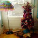 Bring in the Christmas spirit with a tinsel tree set into an upcycled DIY painted hose reel used as a tree base.
