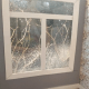 Acetate window with sprayed-on snow.