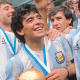Diego Maradona celebrating the world cup win with Argentina.