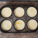 Put a cupcake pan or 6 to 8 baking cups in a 2 1/2 inch pan. Pour custard into the cupcake pan or baking cups. Fill large pan with enough water to reach the rim of the cupcake pan or baking cups.