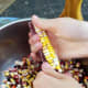 Painted Mountain corn being shelled by hand