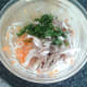 Roast chicken and coriander is added to salad