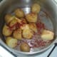 Butter and smoked paprika are added to boiled potatoes