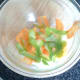 White wine vinegar is added to shaved white turnip, apple and carrot
