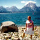 My mother, with Jackson Lake and the Tetons forming the backdrop, at the Signal Mountain boat ramp area