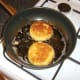 Shallow frying the fish cakes