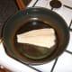 Cod fillet is laid in frying pan skin side down