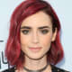 Lily Collins: Blunt bob with wine-red hair.