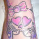 Hello Kitty inspired skull tattoo