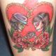 skull tattoos and flowers