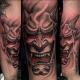 This hannya tattoo has a devilish appearance.