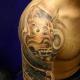 Hannya mask on the shoulder.