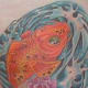 Here is Crystal's finished koi tattoo, now with all of the colors and shading done.