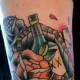 Color Tattoo of a Bottle in a Coffin