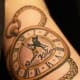 Pocket watch tattoo with text.