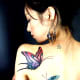 Butterfly tattoo on shoulder of woman