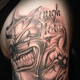 "An example of a ""laugh now, cry later"" arm tattoo."