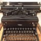 """Seemingly non-related artifacts are placed around the museum, however, as the staff will tell you, seeing these items makes it easier to comprehend history and the historical timeline. """"Folks that used this typewriter would have used this phone"""""""
