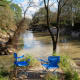 Blue chairs in the park by Cypress Creek