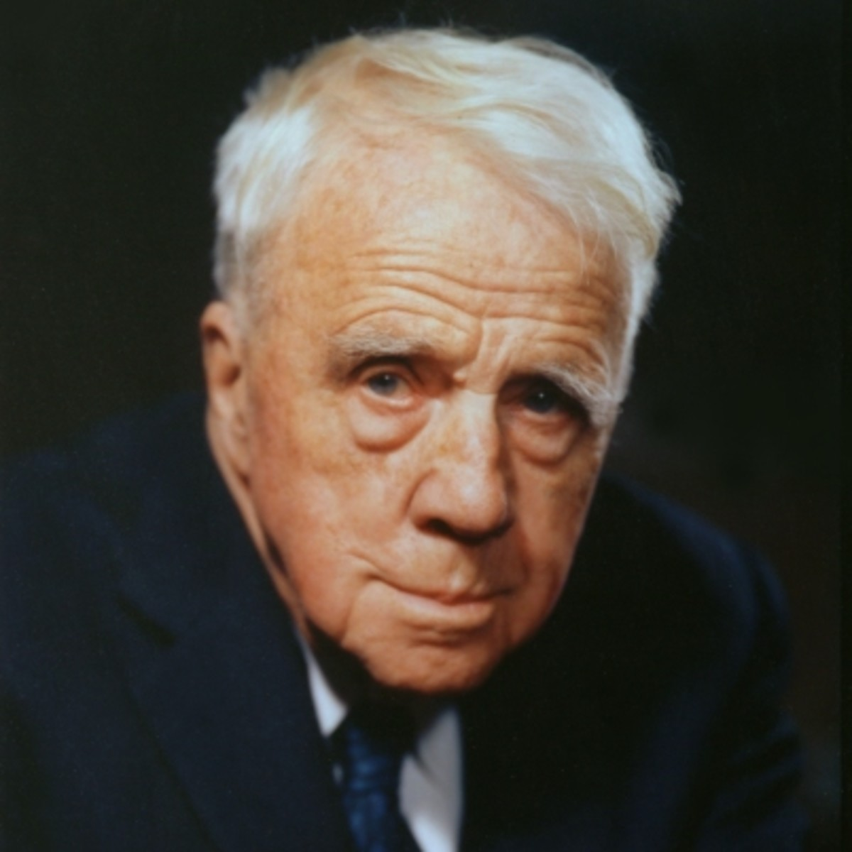 write a biography of robert frost
