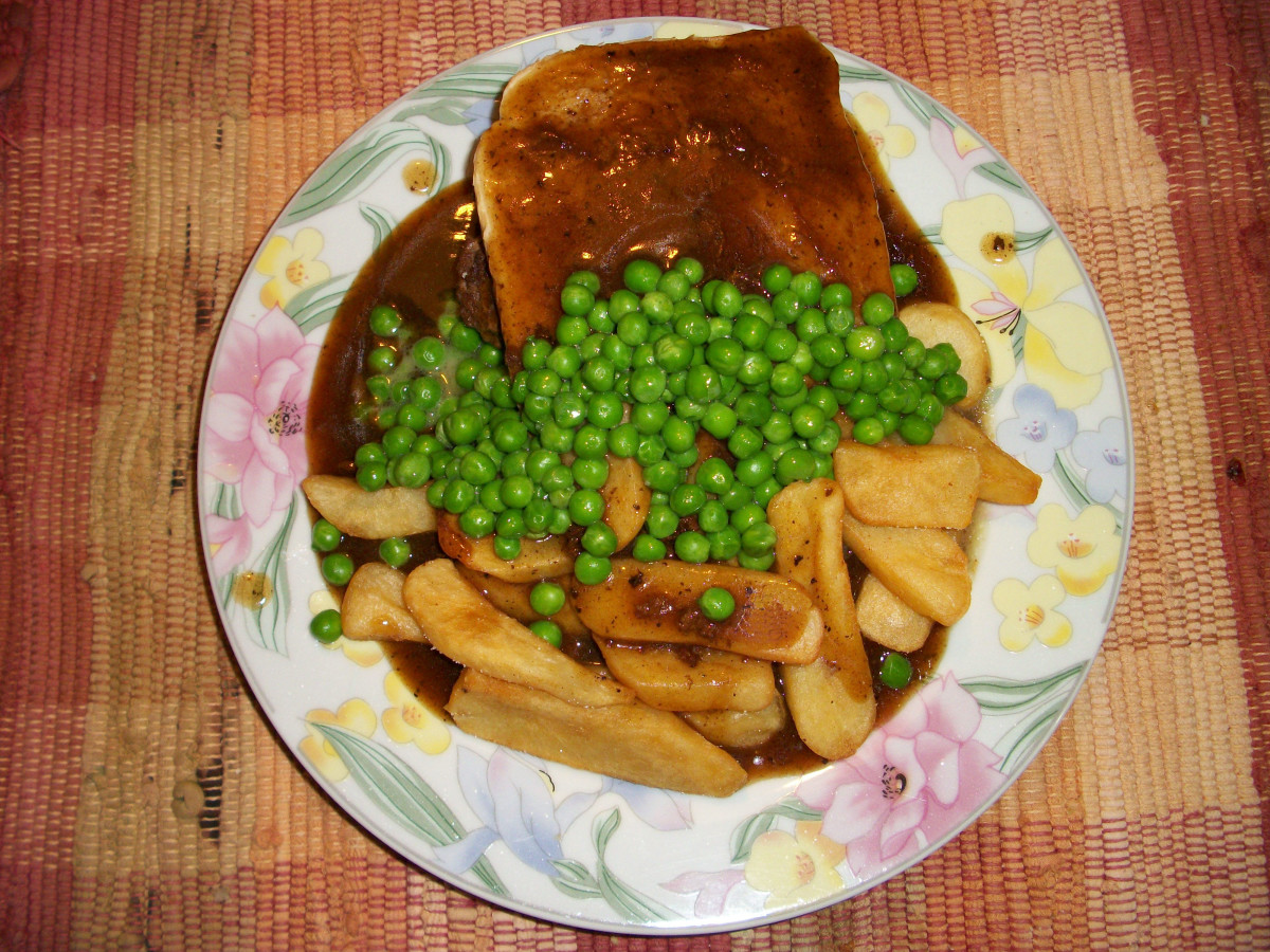 Canadian hot Hamburg sandwich with brown gravy, steak fries, and peas.