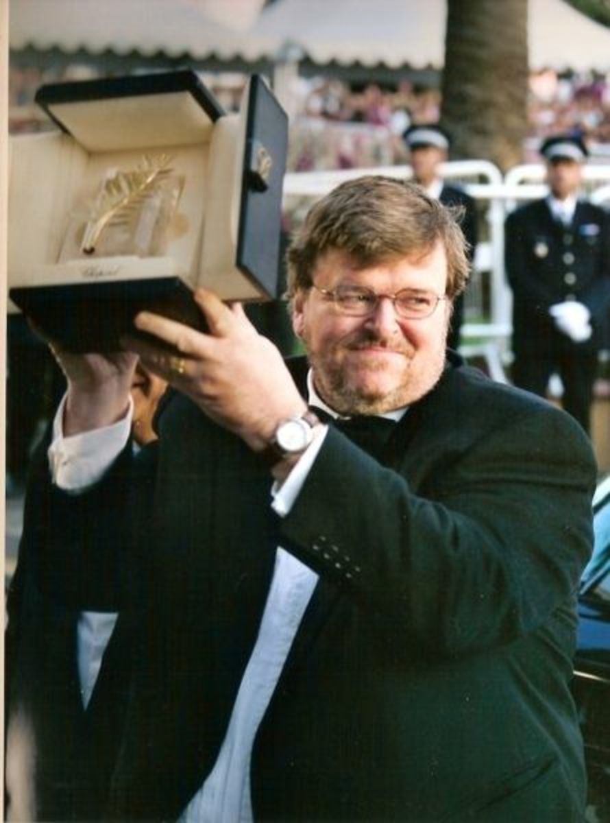 """Michael Moore receiving the Palme d'or at the Cannes film festival, for """"Farenheit 9/11"""""""