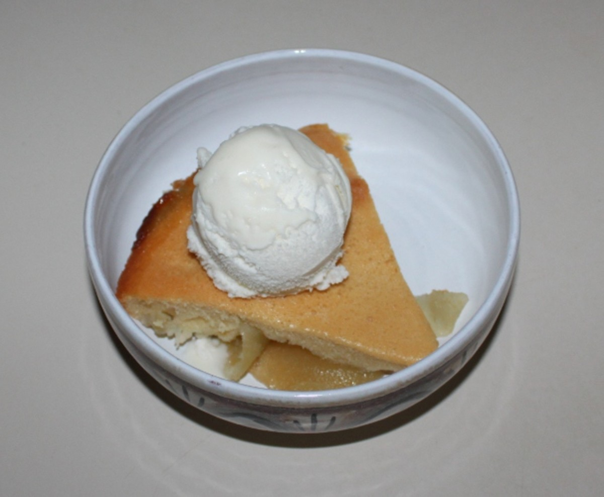 Apple Sponge Pudding - Dessert all ready to eat with a dollop of Ice Cream .