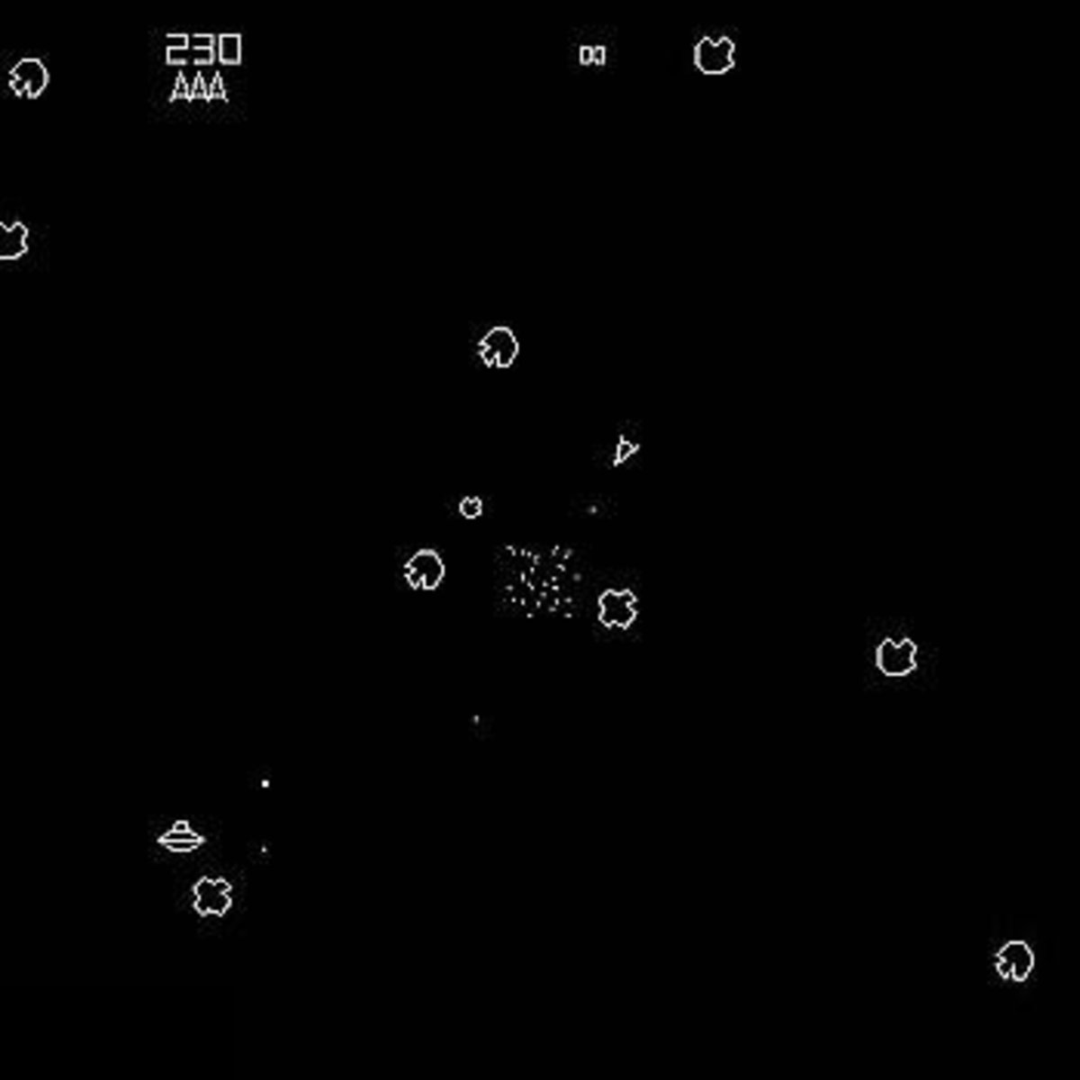Note the vector display in the Asteroids arcade game