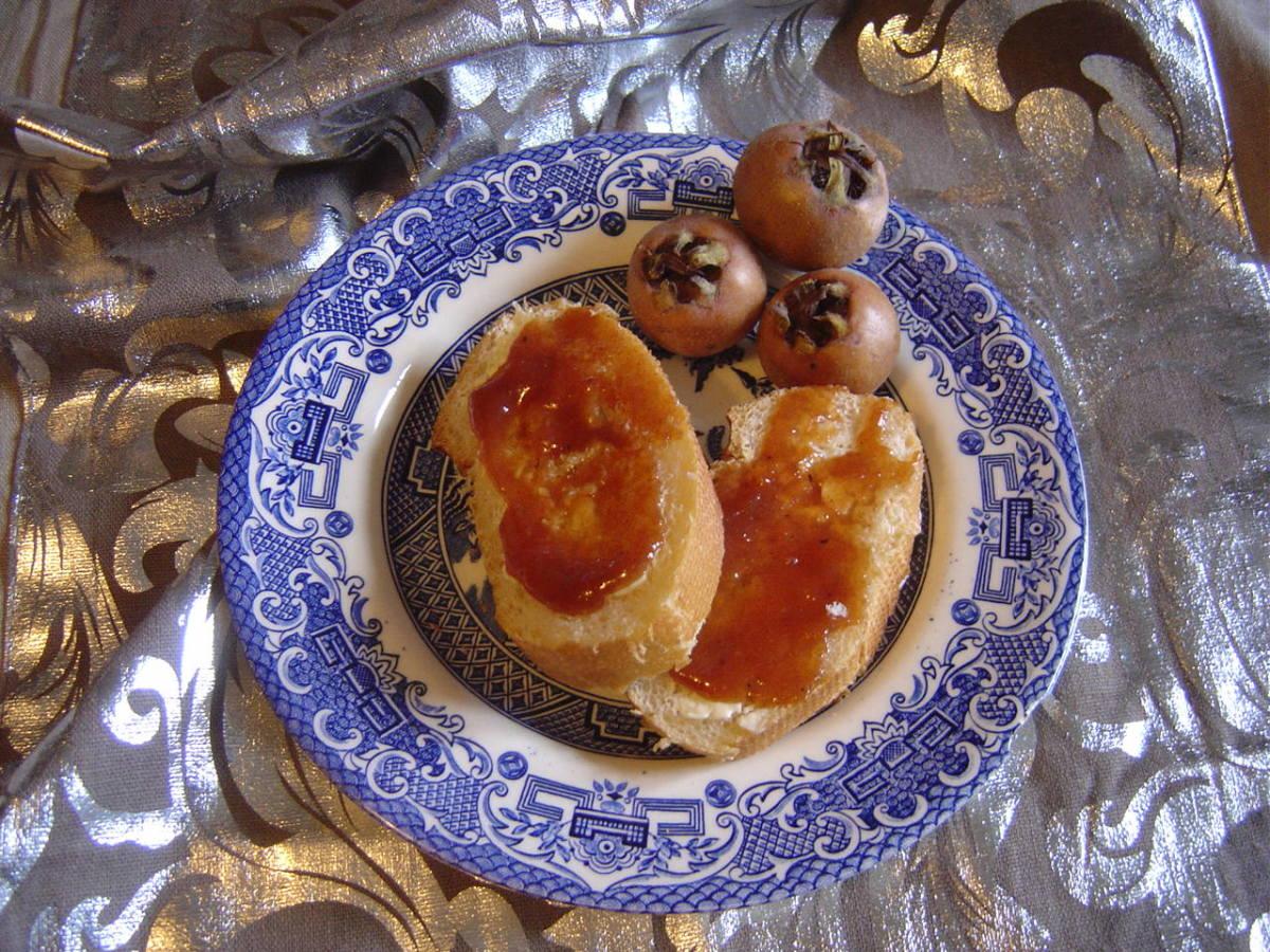 Medlar jam (really a cheese) and medlar fruit.