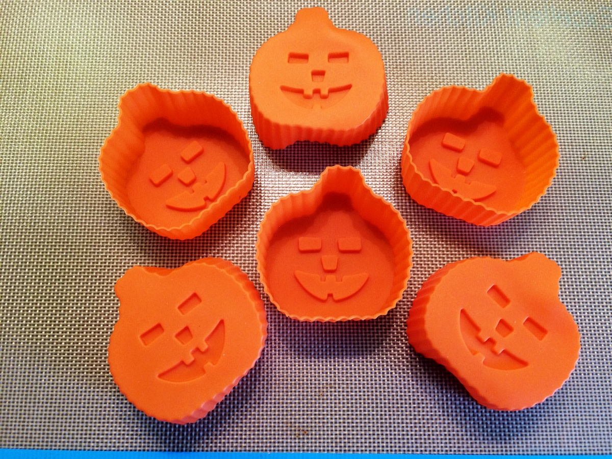 Silicone baking molds come in all shapes and sizes to create the perfect result for any occasion. Pictured, is my daughter's set of Halloween pumpkin cupcake molds
