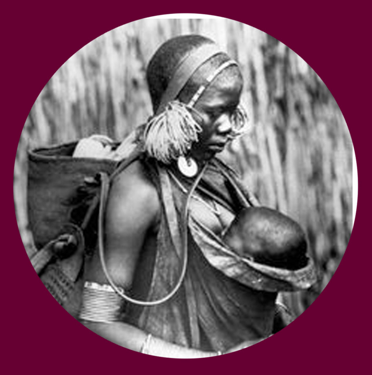 A pre - 1950 (most likely 1930s) Kikuyu woman and child
