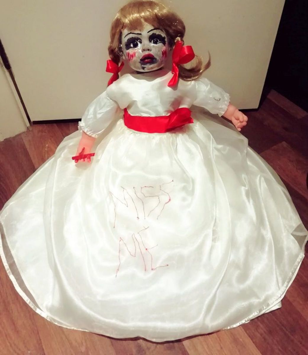 This is my completed evil Annabelle doll decoration.