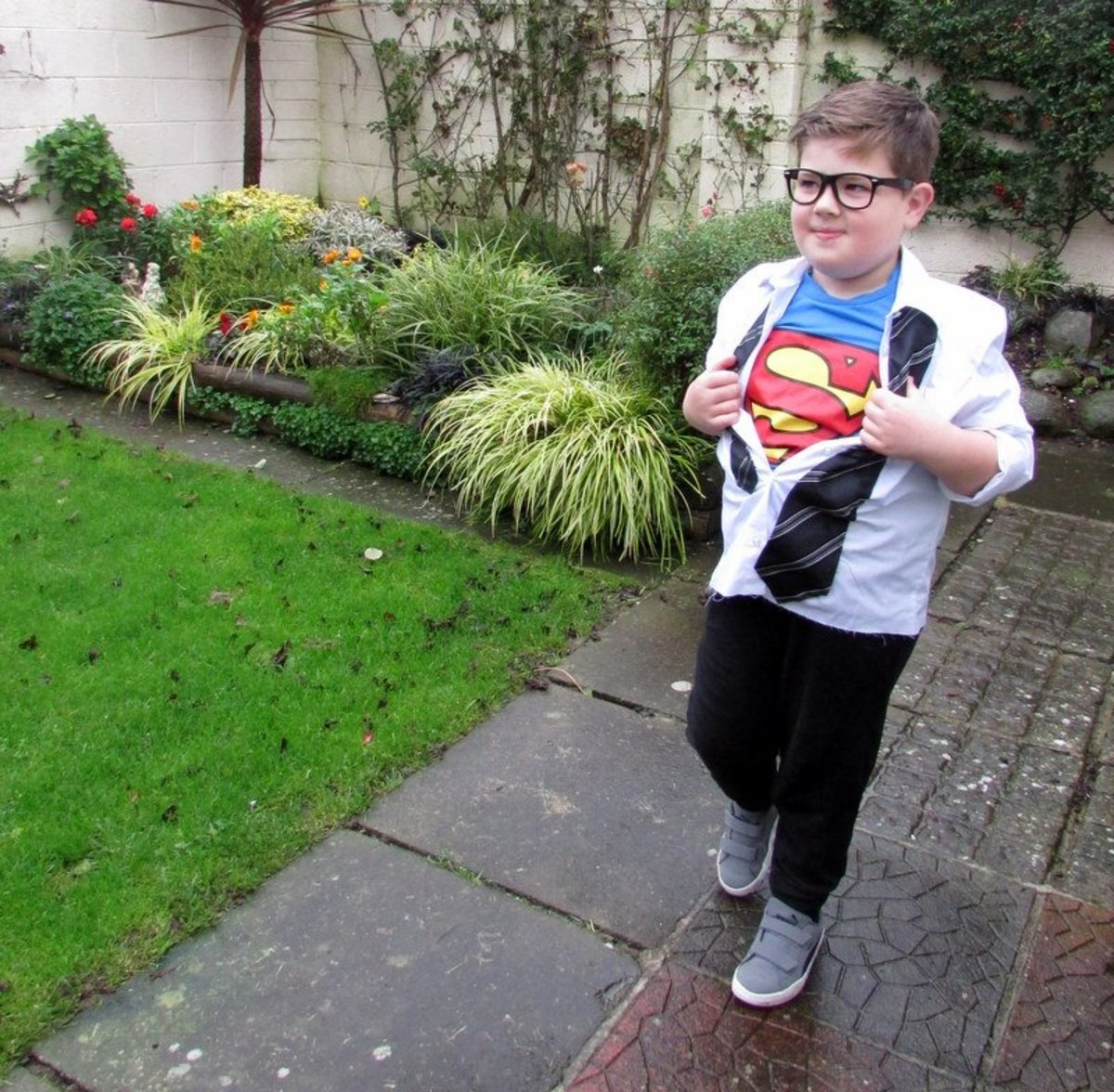 This is my son in his copmpleted Superman/Clark Kent Halloween costume.