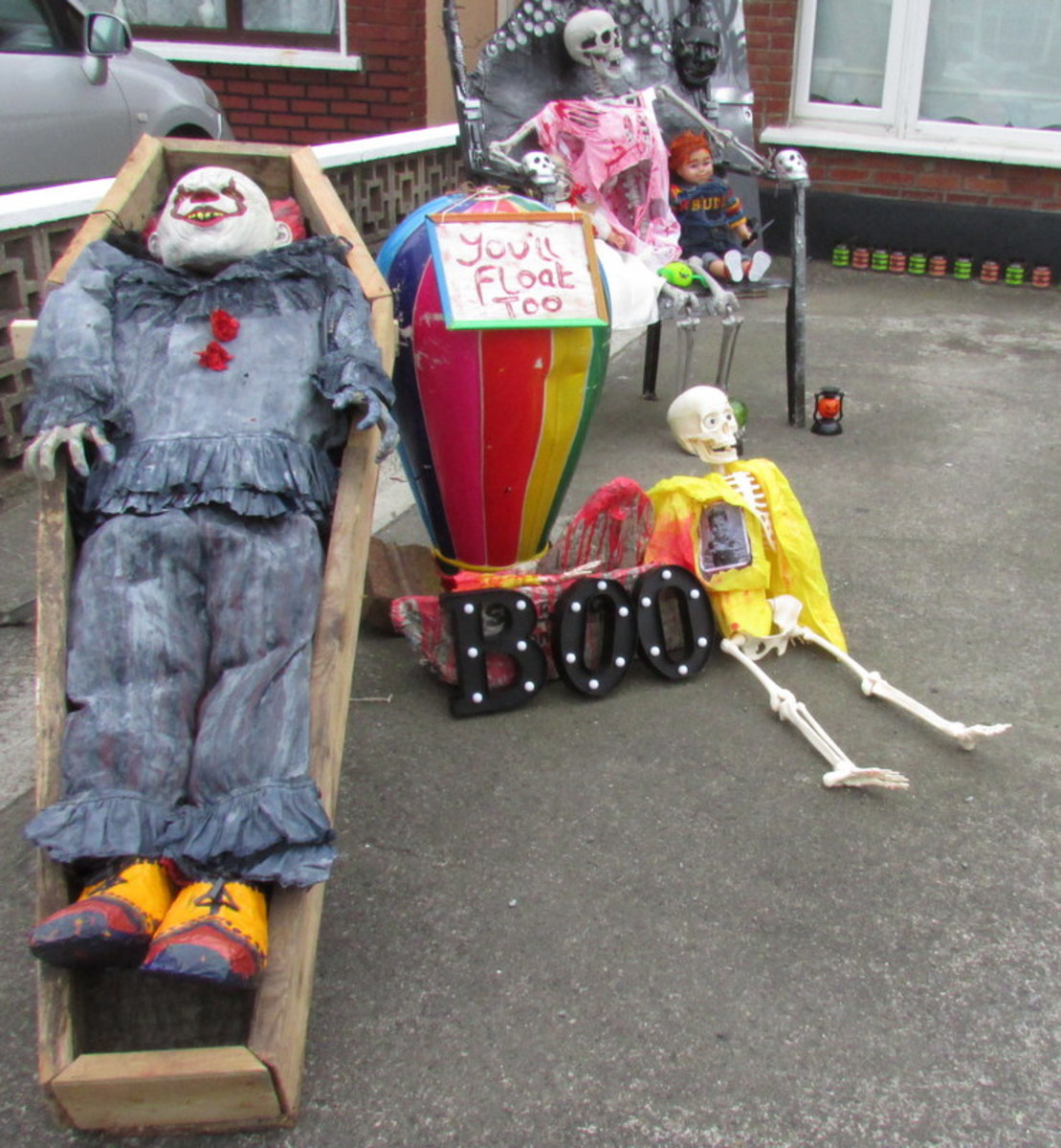 The Georgie skeleton next to my Pennywise Halloween decoration