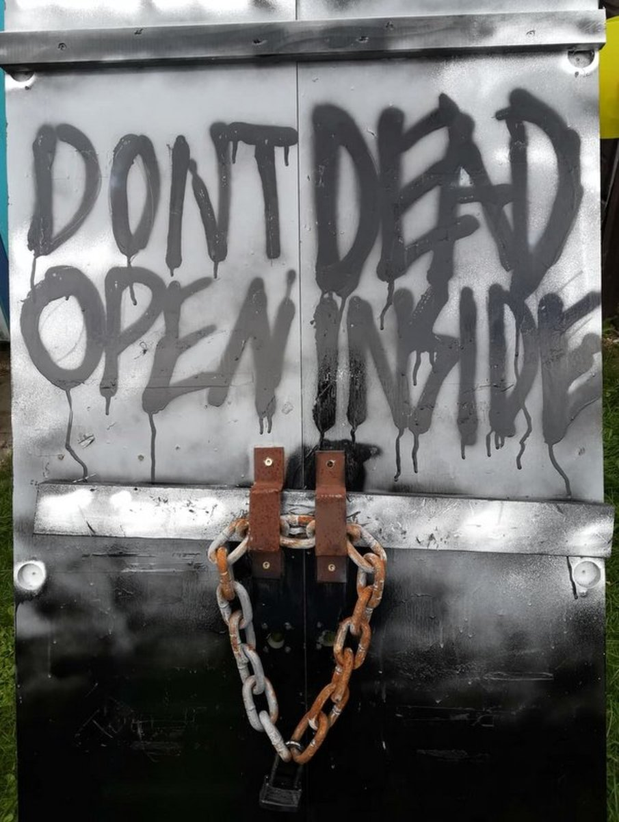 "Learn how to make this zombie door from ""The Walking Dead"" as an awesome Halloween decoration for your display."