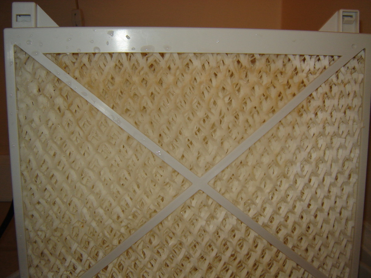 That's a modern humidifier filter after just a few days of use. Worse, it's after having just been cleaned with vinegar.