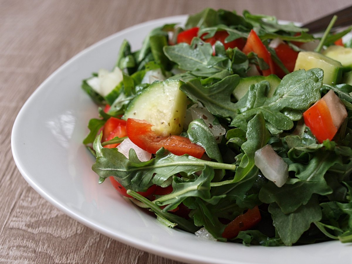My favorite salad, with only 77 calories, includes arugula, cucumber, red pepper, grape tomatoes, sweet onion, and lemon-garlic vinaigrette.