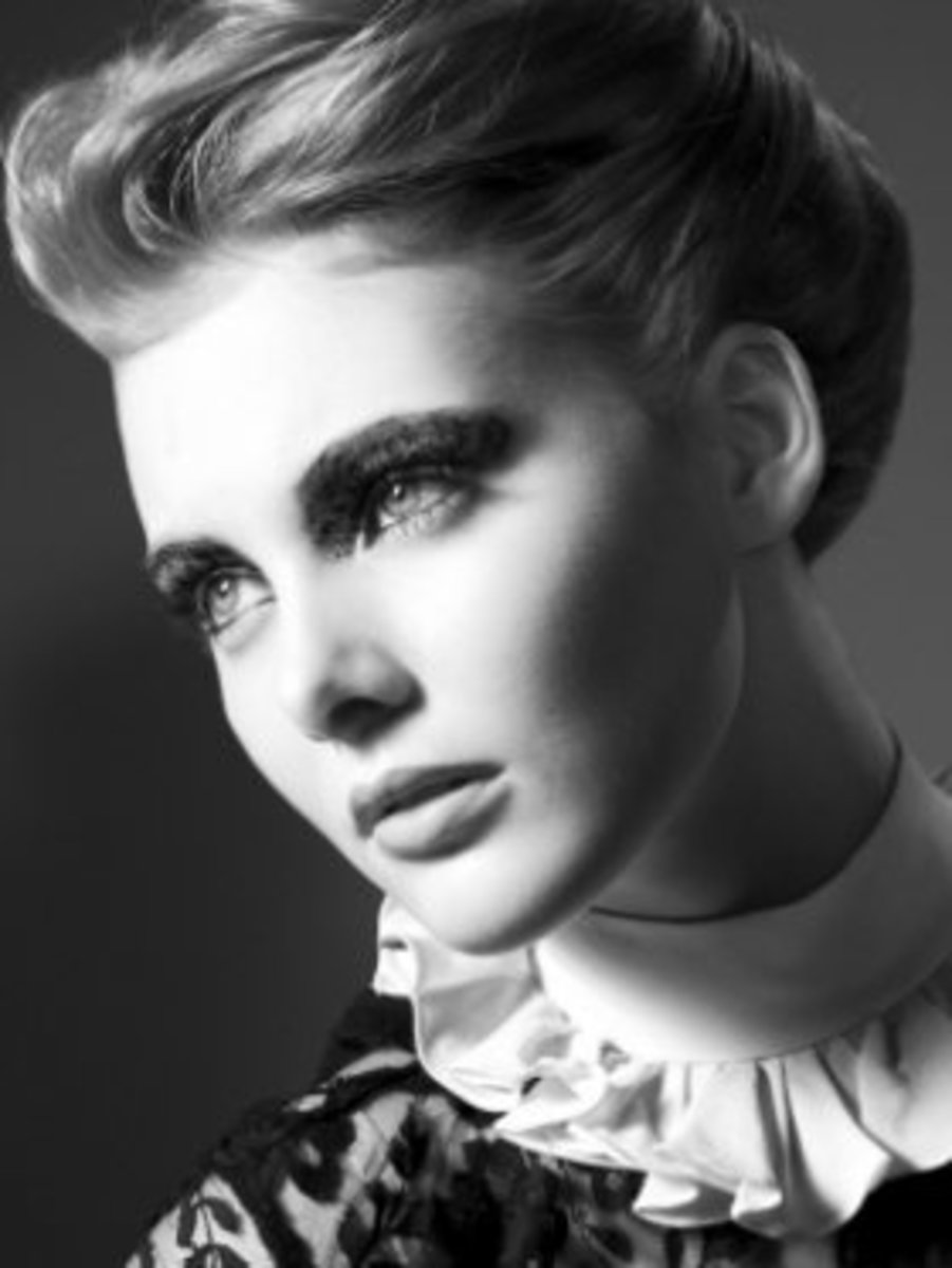 Classic French Elegance: The French twist highlights facial bone structure and eyes, leaving a soft, sexy neck line.