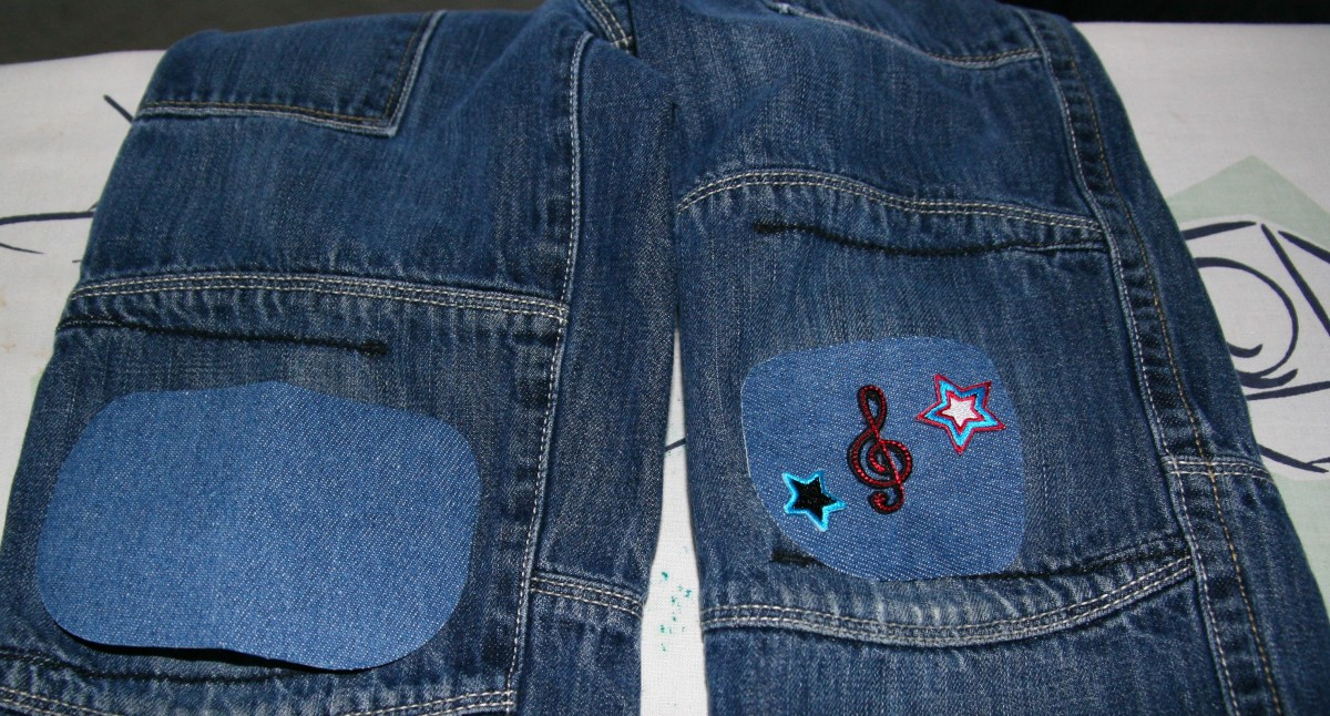 A patch is placed over the torn knee on the left. A patch (with applique) is already ironed on the right knee.