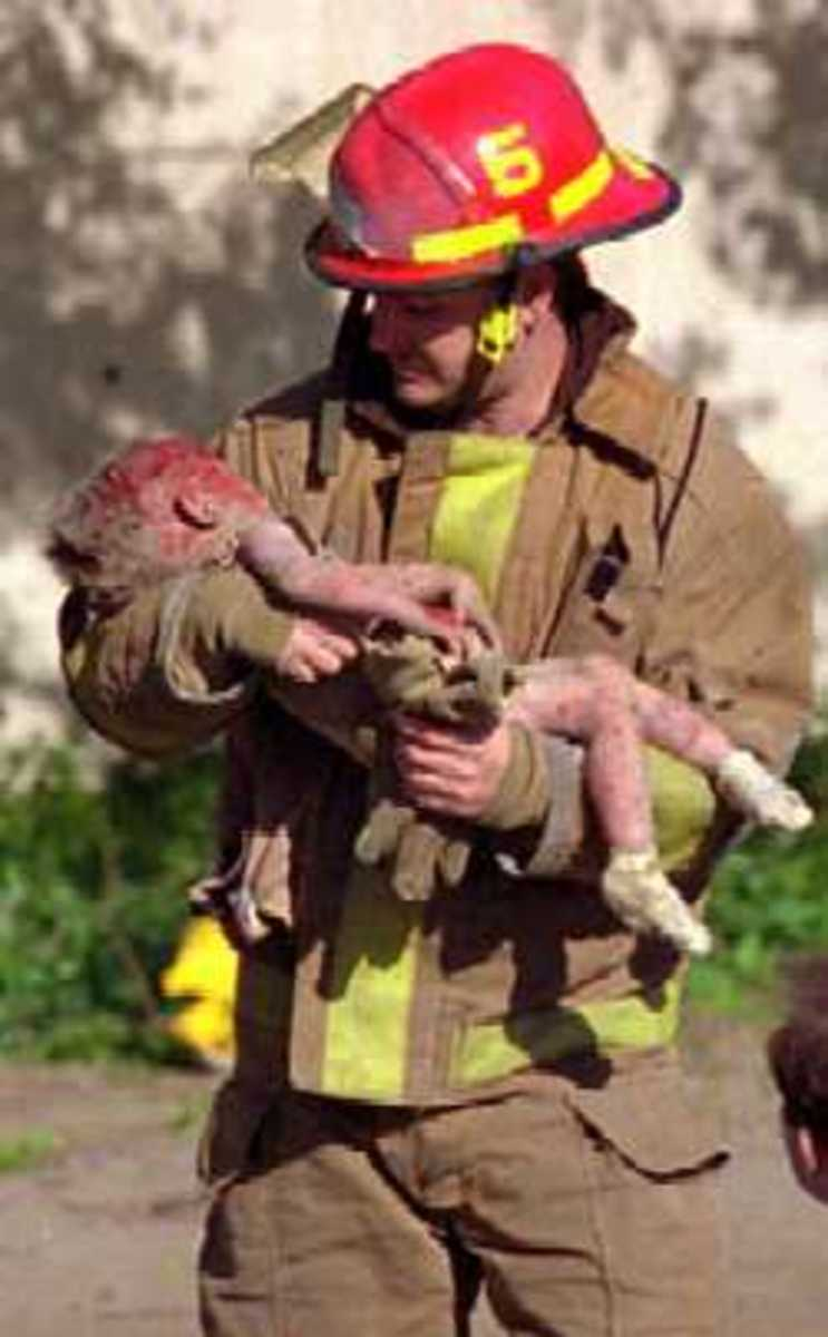 A firefighter saves a child. It's what we do!!!