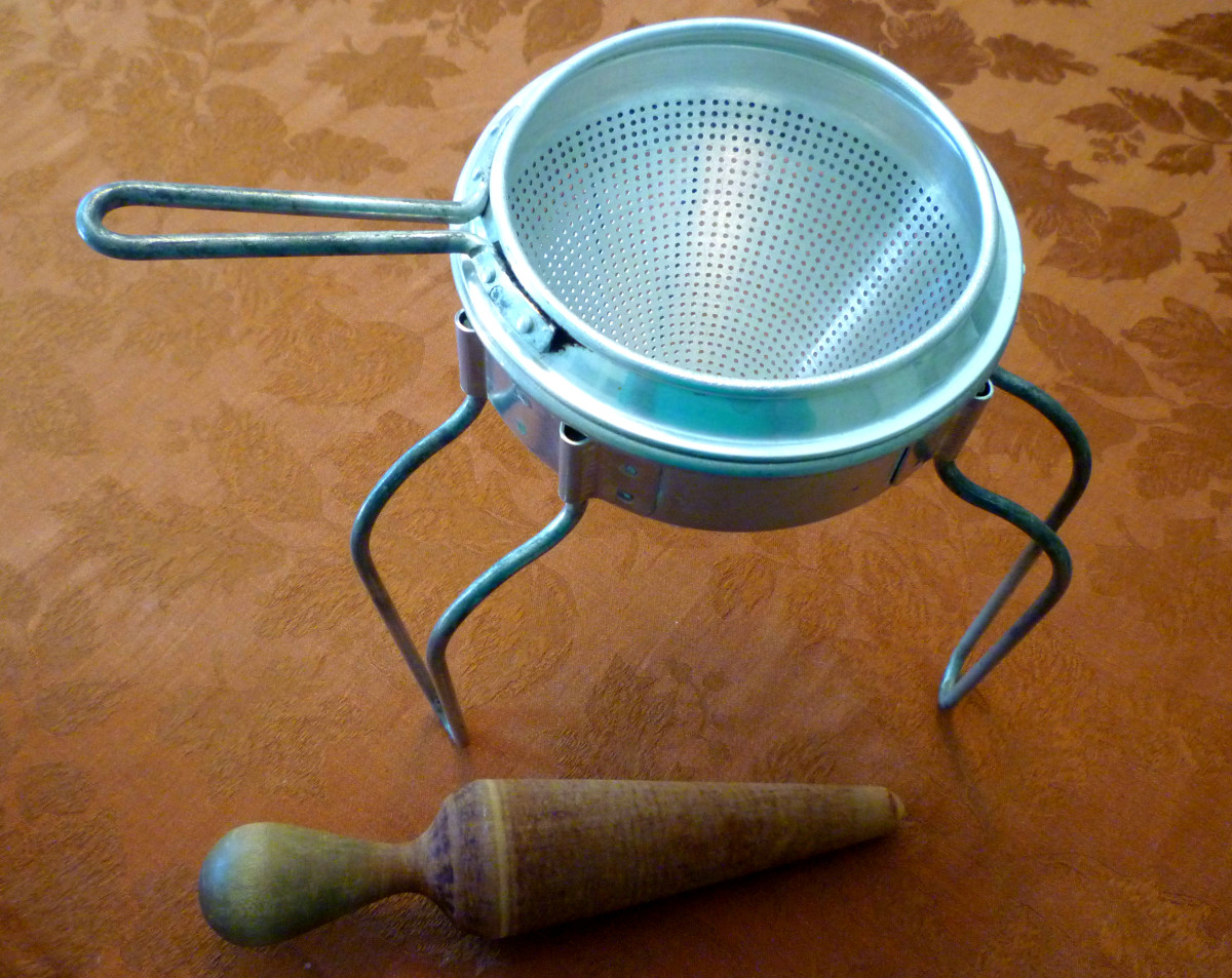 Old cone shaped food mill with stand and pestle given to me from my grandmother.
