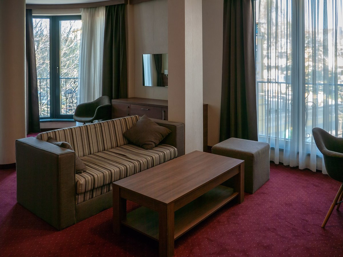 Couch and coffee table in a hotel room.