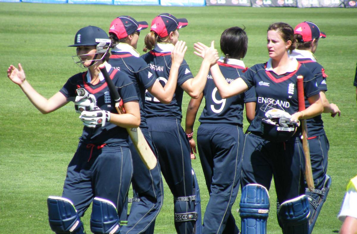women finishing a cricket game
