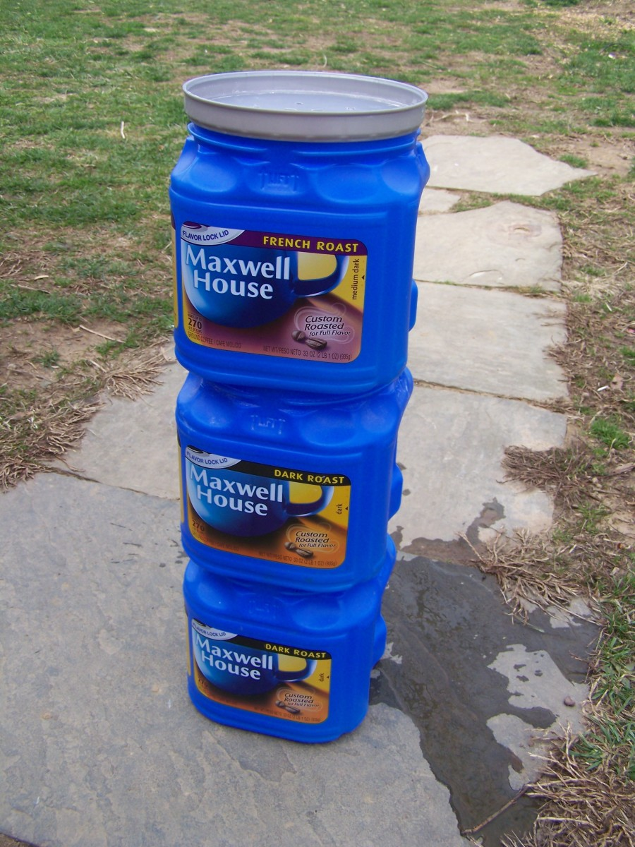 My stacked, flow-through, worm composter made with three plastic coffee cans.
