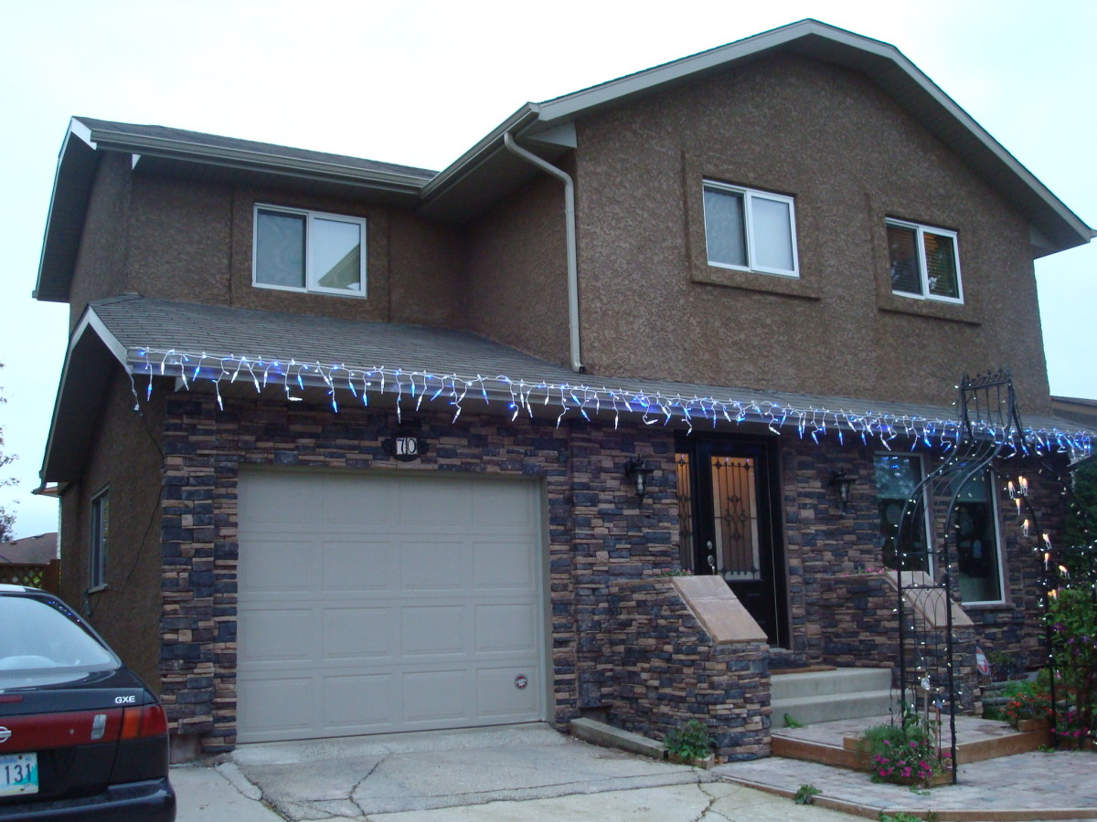 How to install stone veneer on the front of your house for Stone veneer house pictures